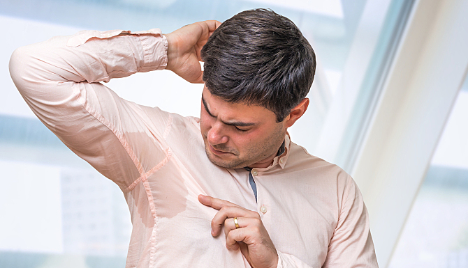Business Man With Sweating Under Armpit In Office