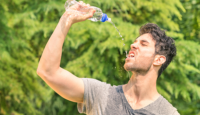 Sporty Man Refreshing With Cold Water After Run Training In The Park - Sport Fitness Haappy Model